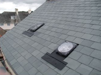 Finished light dome fitting in natural slate roof